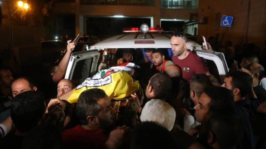 إسرائيل تسلم جثمان فلسطيني استشهد