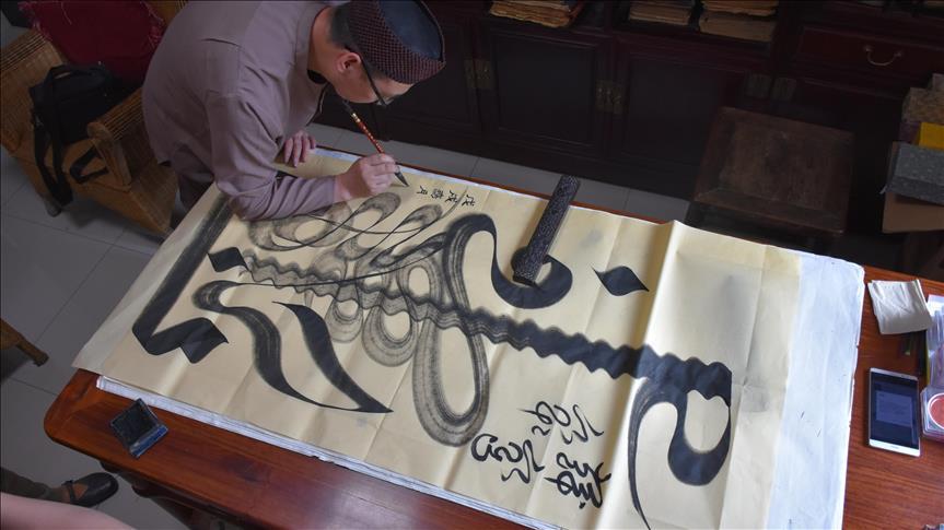 إمام صيني يسعى لحماية خط عربي من الاندثار